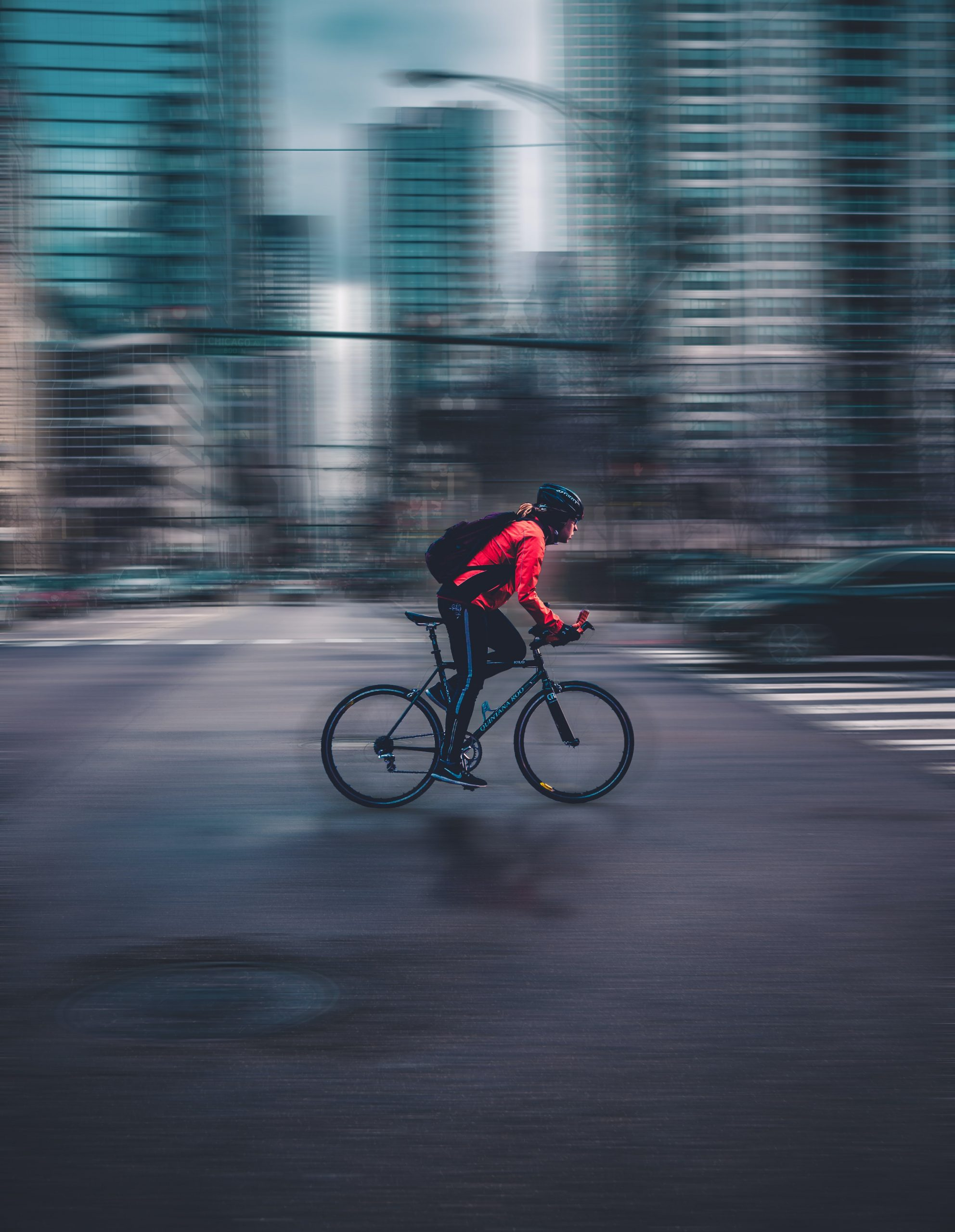 a person cycling in a city