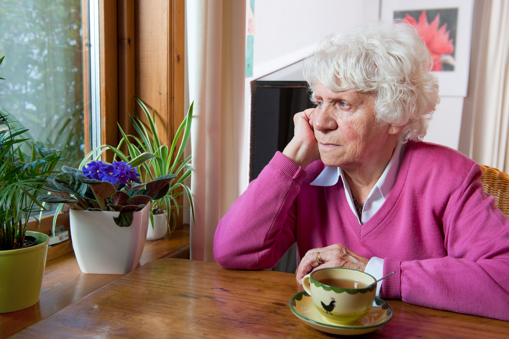 Lonely old woman in negligent nursing home